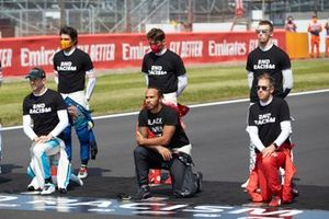 Carlos Sainz Jr., McLaren, Charles Leclerc, Ferrari, Daniil Kvyat, AlphaTauri, Nicholas Latifi, Williams Racing, Lewis Hamilton, Mercedes-AMG Petronas F1, and Sebastian Vettel, Ferrari, stand and kneel in support of the End Racism campaign