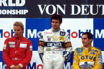 Stefan Johansson, McLaren, Race Winner Nelson Piquet, Williams. Ayrton Senna, Lotus