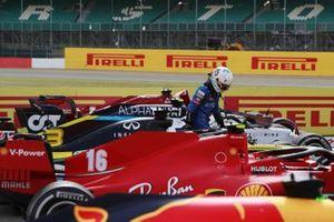 Lando Norris, McLaren, exits his car in parc ferme