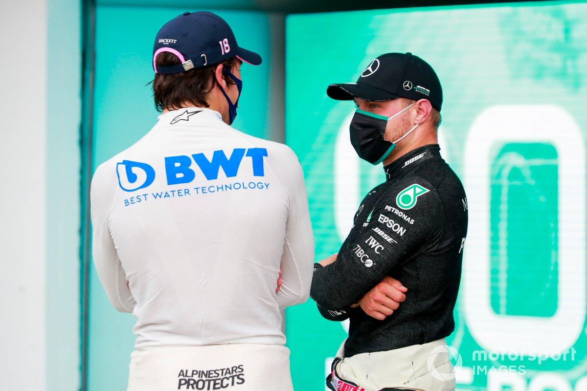 Tercero Lance Stroll, Racing Point y el segundo Valtteri Bottas, Mercedes-AMG Petronas F1 en Parc Ferme