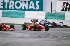 Michael Schumacher, Ferrari F2001, without his front wing after making contact with Juan Pablo Montoya, Williams FW24 BMW