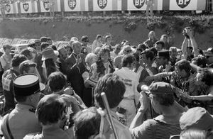 Race winner Jochen Rindt celebrates in parc ferme with his team