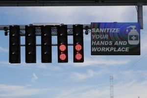 Sanitize Your Hands and Workplace reminder on start finish straight