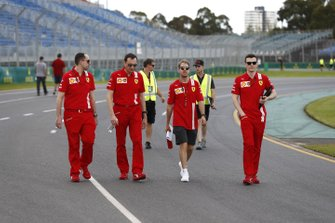 Sebastian Vettel, Ferrari walks the track with members of his team