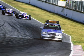 The safety car leads Jacques Villeneuve, Williams FW19 Renault, and Heinz-Harald Frentzen, Williams FW19, Renault