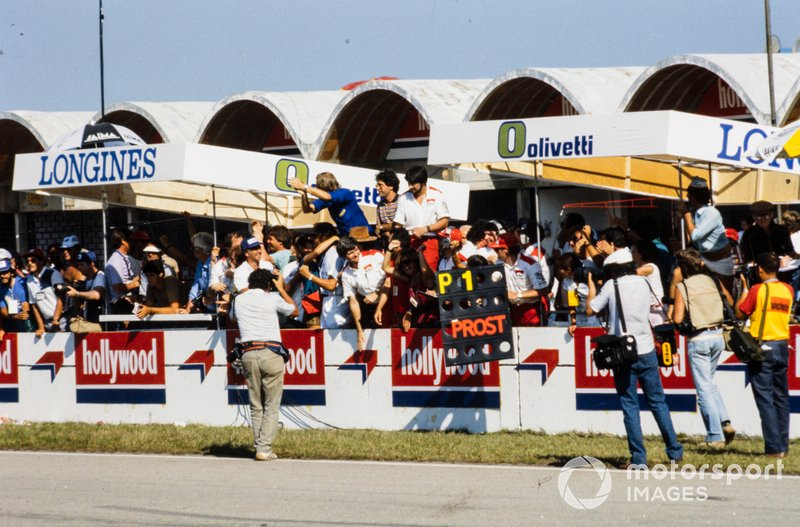McLaren members celebrate Alain Prost's victory