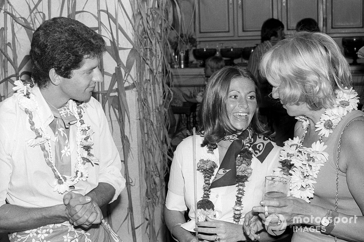 Jody Scheckter, Tyrrell, with wife Pam and Norah Tyrrell, wife of Ken Tyrrell, Tyrrell Team Owner, at a themed party