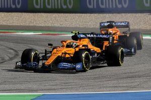 Lando Norris, McLaren MCL35, leads Carlos Sainz Jr., McLaren MCL35