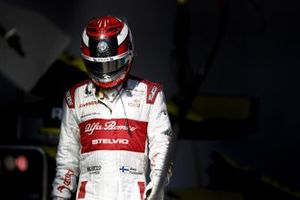 Kimi Raikkonen, Alfa Romeo, walks back to his garage after retiring from the race