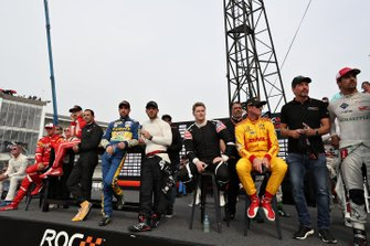 The drivers watch the action
