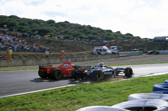 Michael Schumacher (Ferrari F310B), Jacques Villeneuve (Williams FW19 Renault)