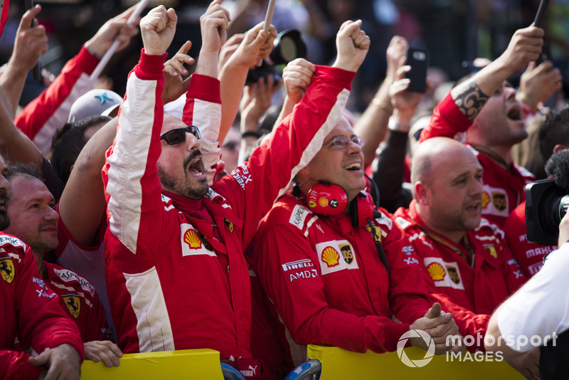 Ferrari team personnel celebrate as Kimi Raikkonen, Ferrari, 1st position, takes to the podium