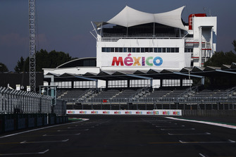 The pit straight grandstand and circuit detail, including Mexico branding