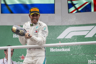 Lewis Hamilton, Mercedes AMG F1 celebrates on the podium with the champagne