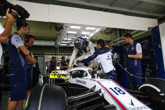 Lance Stroll, Williams FW41, climbs into his car