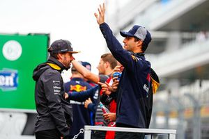 Daniel Ricciardo, Red Bull Racing, waves to the crowds on the drivers parade with Fernando Alonso, McLaren
