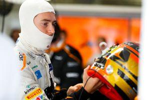 Stoffel Vandoorne, McLaren, adjusts his crash helmet