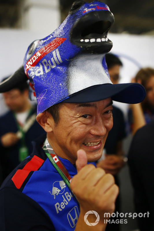 A Toro Rosso Honda fan wears a novel hat.