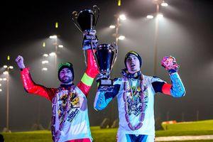 Mattia Pasini and Lorenzo Baldassarri celebrating their podium