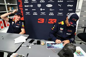 Max Verstappen, Red Bull Racing and Daniel Ricciardo, Red Bull Racing sign autographs