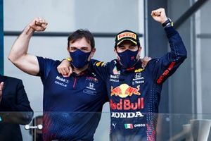 Sergio Perez, Red Bull Racing, 1st position, celebrates with his team mate on the podium