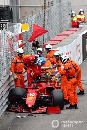 Marshals assist Charles Leclerc, Ferrari SF21, after he crashes out of Qualifying