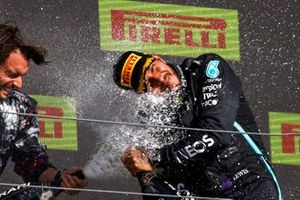 Lewis Hamilton, Mercedes, 1st position, is sprayed with Champagne on the podium by his team mate