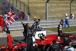 Lewis Hamilton, Mercedes, 1st position, celebrates after the race whilst parading the Union flag