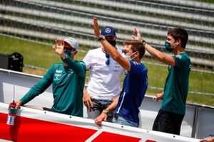 Sebastian Vettel, Aston Martin, George Russell, Williams and Lance Stroll, Aston Martin wave at fans from the drivers parade lorry