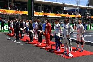 The drivers stand with Stefano Domenicali, CEO, Formula 1, for the national anthem prior to the start