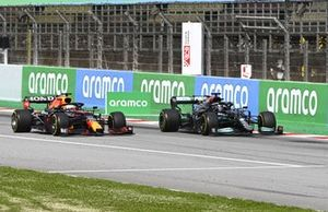 Lewis Hamilton, Mercedes W12, passes Max Verstappen, Red Bull Racing RB16B, for the lead