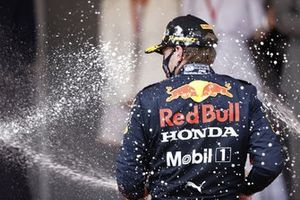 Max Verstappen, Red Bull Racing, 1st position, sprays the victory Champagne on the podium