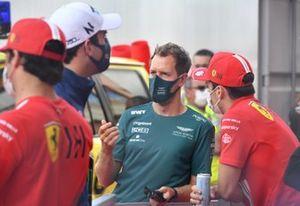 Sebastian Vettel, Aston Martin, and Charles Leclerc, Ferrari