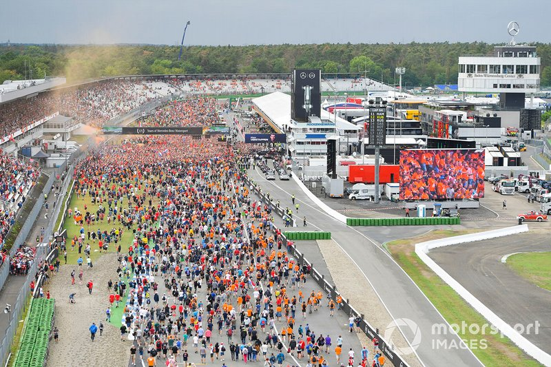 Fans invade the circuit in celebration at the end of the race