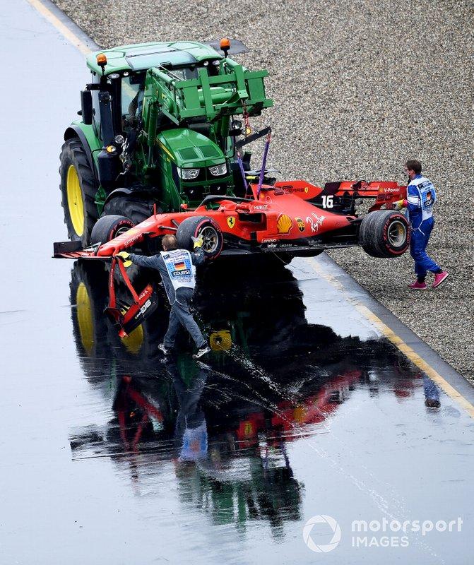 Marshals remove the damaged car of Charles Leclerc, Ferrari SF90