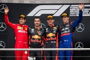 Sebastian Vettel, Ferrari, Race winner Max Verstappen, Red Bull Racing and Daniil Kvyat, Toro Rosso celebrate on the podium
