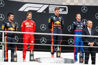 Podium: race winner Max Verstappen, Red Bull Racing, second place Sebastian Vettel, Ferrari, third place Daniil Kvyat, Toro Rosso