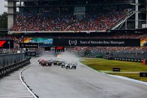 Lewis Hamilton, Mercedes AMG F1 W10 leads Valtteri Bottas, Mercedes AMG W10 and Max Verstappen, Red Bull Racing RB15 at the start of the race