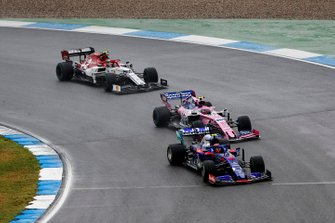 Alexander Albon, Toro Rosso STR14, leads Lance Stroll, Racing Point RP19, and Antonio Giovinazzi, Alfa Romeo Racing C38
