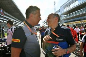 Mario Isola, Racing Manager, Pirelli Motorsport, and Franz Tost, Team Principal, Toro Rosso, on the grid