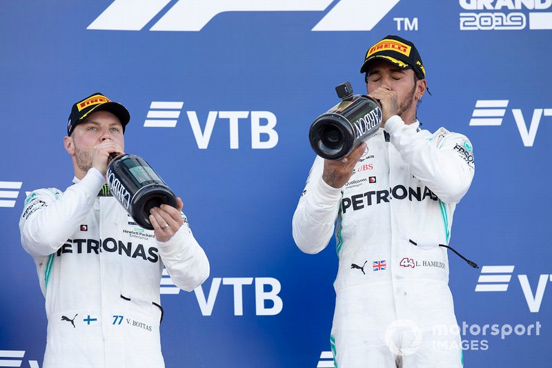 second place Valtteri Bottas, Mercedes AMG W10 and race winner Lewis Hamilton, Mercedes AMG F1 W10 drink champagne on the podium
