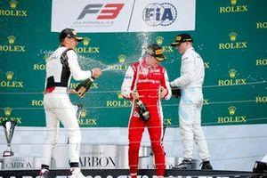 Leonardo Pulcini, Hitech Grand Prix, Race winner Marcus Armstrong, PREMA Racing and Jake Hughes, HWA RACELAB celebrate on the podium with the champagne