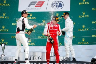 Leonardo Pulcini, Hitech Grand Prix, Race winner Marcus Armstrong, PREMA Racing and Jake Hughes, HWA RACELAB celebrate on the podium with the champagne