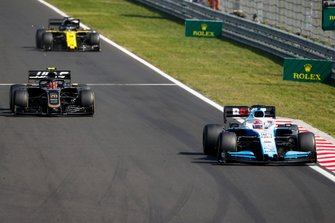George Russell, Williams Racing FW42, leads Kevin Magnussen, Haas F1 Team VF-19, and Daniel Ricciardo, Renault F1 Team R.S.19