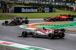 Romain Grosjean, Haas F1 Team VF-19, leads Sebastian Vettel, Ferrari SF90, as Antonio Giovinazzi, Alfa Romeo Racing C38, spins