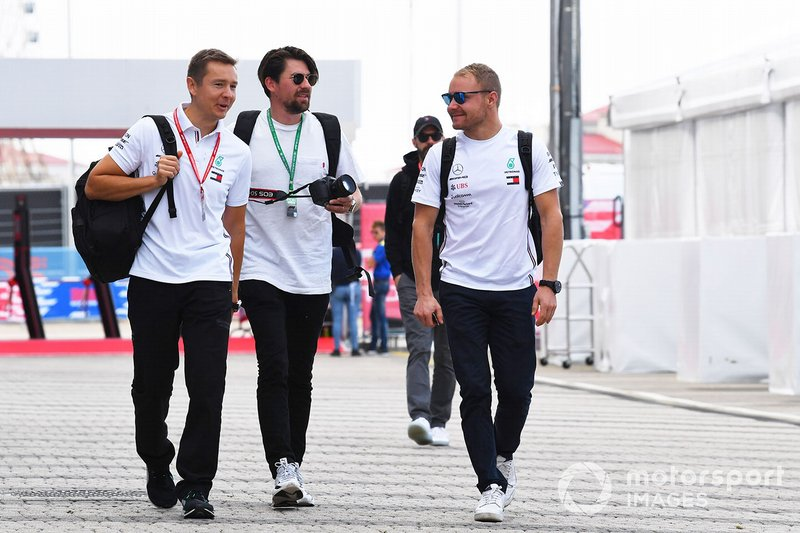 Valtteri Bottas, Mercedes AMG F1, arrives in the paddock