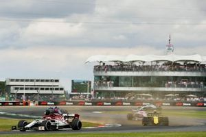 Kimi Raikkonen, Alfa Romeo Racing C38, leads Nico Hulkenberg, Renault F1 Team R.S. 19, Lance Stroll, Racing Point RP19, and the remainder of the field at the start