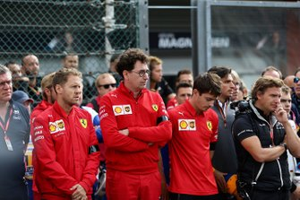 Sebastian Vettel, Ferrari, Mattia Binotto, Team Principal Ferrari, Charles Leclerc, Ferrari, stand on the grid for the memorial of Anthoine Hubert