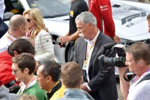 Chase Carey, Chairman, Formula 1, stand on the grid for the memorial of Anthoine Hubert