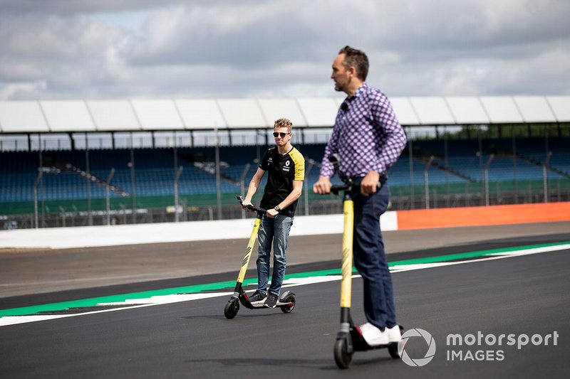 Nico Hulkenberg, Renault F1 Team walks the track on a scooter